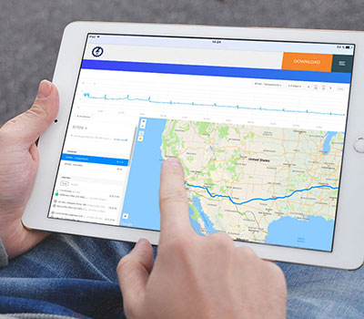 Man holding iPad with Blue Lightning Logistics route map